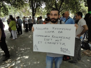 """Protester's sign: """"No to cutting trees, but yes to cutting animals?  Meat is murder"""""""