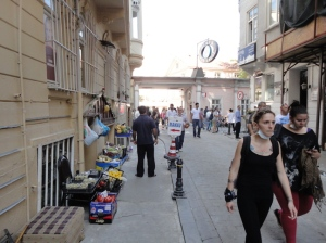 Off Sıraselviler: a grocer open for business, with plenty of lemons—used to neutralize tear gas