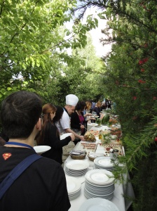 Buffet line among the trees