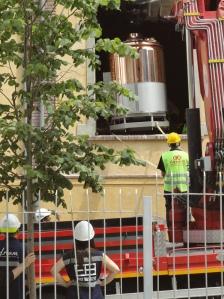 Hardhats delivering copper beer kettle