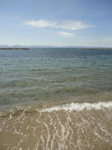 Sand, sea, mountains, sky